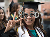 "Graduate wearing ""Grad"" glasses"