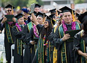 Graduates celebrating during Commencement